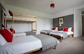 Room 1, ground floor ensuite family room with three single beds and double bunk
